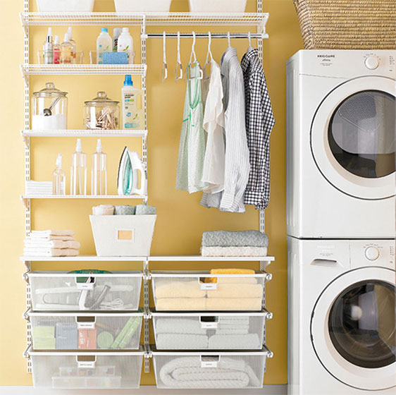 White Elfa Laundry Room with Mesh Drawers and Folding Surface